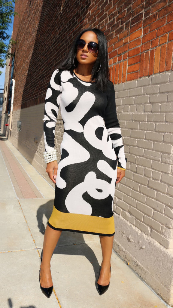 It's all in the Graffiti Long Sleeve Fitted Knit Dress