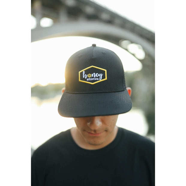 Snap back hat by Honey Athletica