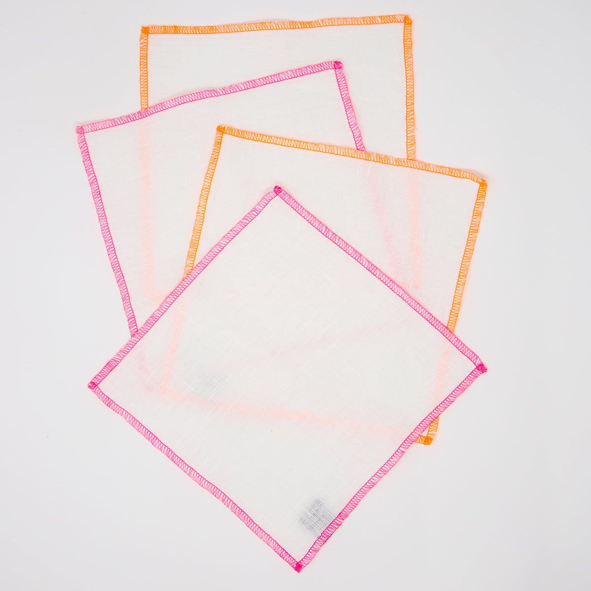 "Pink/Orange Edge 7"" Square <br> Set of 4 cocktail napkins<br> by The Everyday Co."