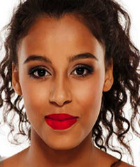 African American woman wearing Argentine Red Tango lipstick by Plum & York