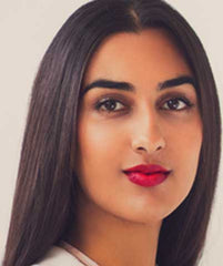 Indian woman wearing Argentine Red Tango lipstick by Plum & York, red lipstick for brown skin