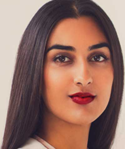 Indian woman wearing Mexican Fiesta Roja lipstick by Plum & York, makeup for brown skin