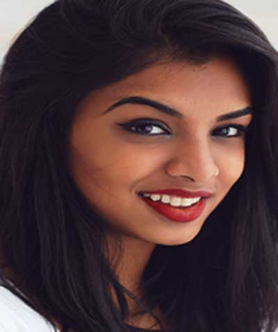 Indian woman wearing Mexican Fiesta Roja lipstick by Plum & York