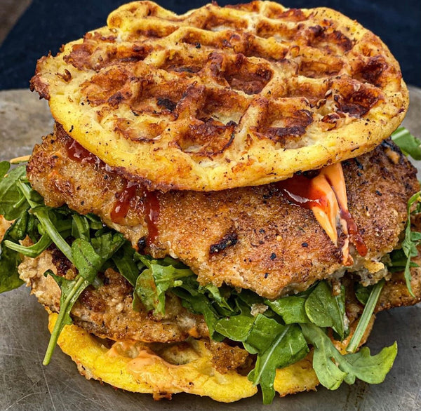 Pork Panko encrusted pork cutlet 'chaffle' with Arugula sriracha mayo.