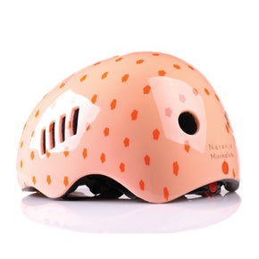 Kids bike helmet with polka dot design left view