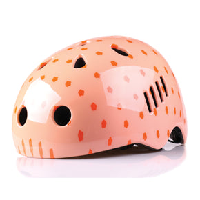 Kids bike helmet with polka dot design front view
