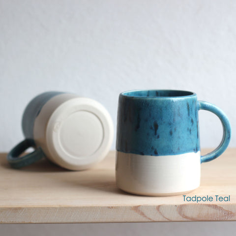 In this photo there is a mug in Tadpole Teal which is one of the colour options available in FICH mugs.
