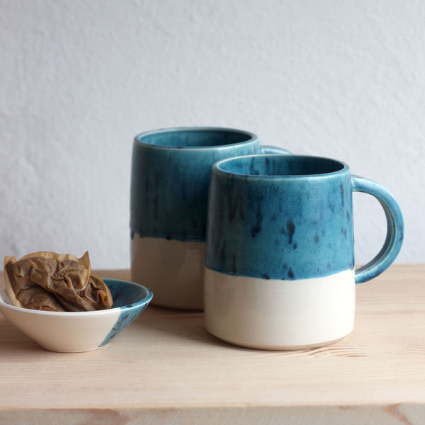 In this photo there is a mug in Tadpole Teal which is one of the colour options available in FICH mugs. It also includes a 'Old Bag' Teabag holder which is also available in the FICH website shop.