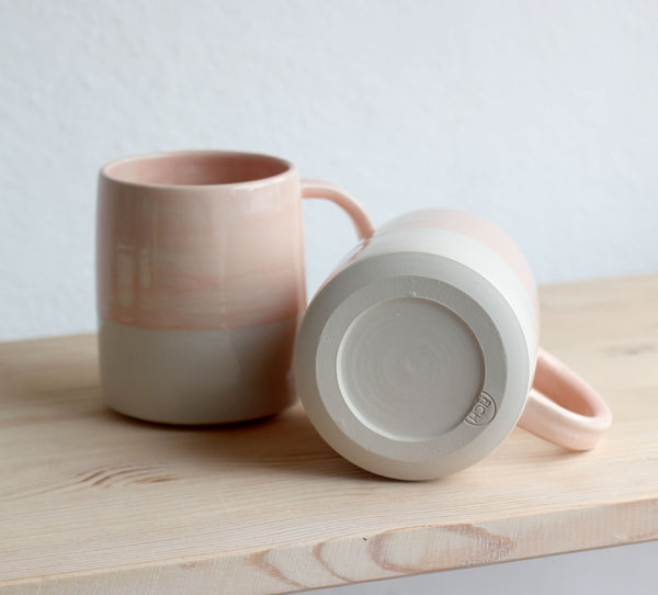 In this photo there is a mug in Misty Rose which is one of the colour options available in FICH mugs.
