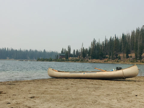 Canoe on shore beach at Three Creeks Lake in Sisters, Oregon