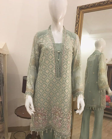 Teal & White Self-embroidered Tunic Shirt with Cut-work Border Neckline, Pleated Details on Shoulder and Embellished & Embroidered Motifs at the Hem (Slip and Plain Pants included)