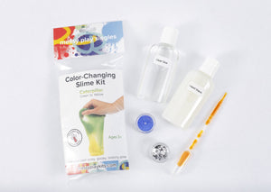 Packaging and contents of a Caterpillar slime kit, including a glue bottle, liquid starch bottle, glitter, and color-changing pigment that changes the slime from green to yellow based on temperature.
