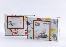 Load image into Gallery viewer, Splatter painted box package of Dinosaur Dig Messy Play Kit, showing front and back of package.