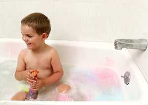 Child in bathtub playing with spray bottle from Bath Tub Fun Messy Play Kit