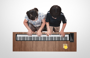 PIANOLITE™ PORTABLE ELECTRONIC PIANO WITH SPEAKER