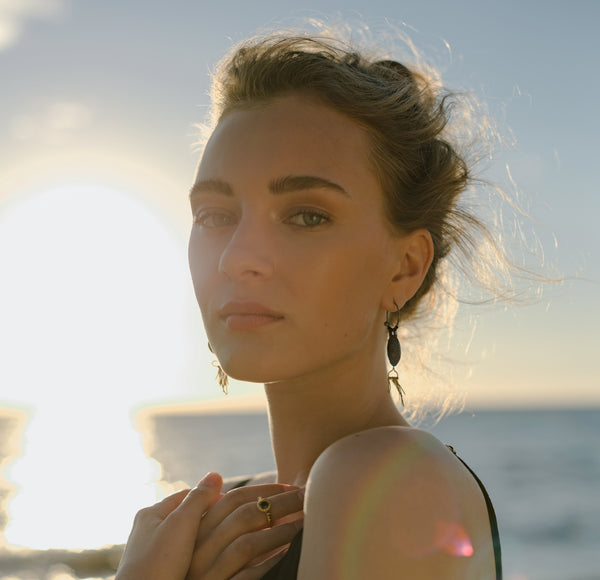 Giselle Martin wearing Fiona Fitzgerald Jewellery's Cycladic Pan Earrings at the beach