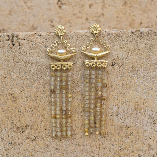 Fertile Crescent Earrings by Fiona Fitzgerald Jewellery on sandstone background