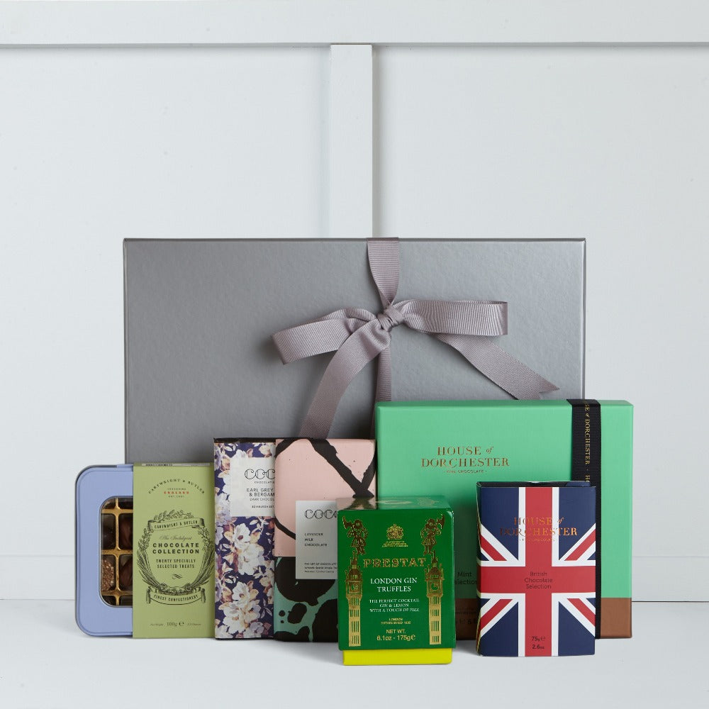 This gift box includes Union Jack Best of British Selection by House of Dorchester, Mint Selection by House of Dorchester, Gin Truffles by Prestat, Earl Grey Tea Dark Chocolate Bar by Coco Chocolatier, Lavender Milk Chocolate Bar by Coco Chocolatier and Chocolate Collection by Cartwright & Butler