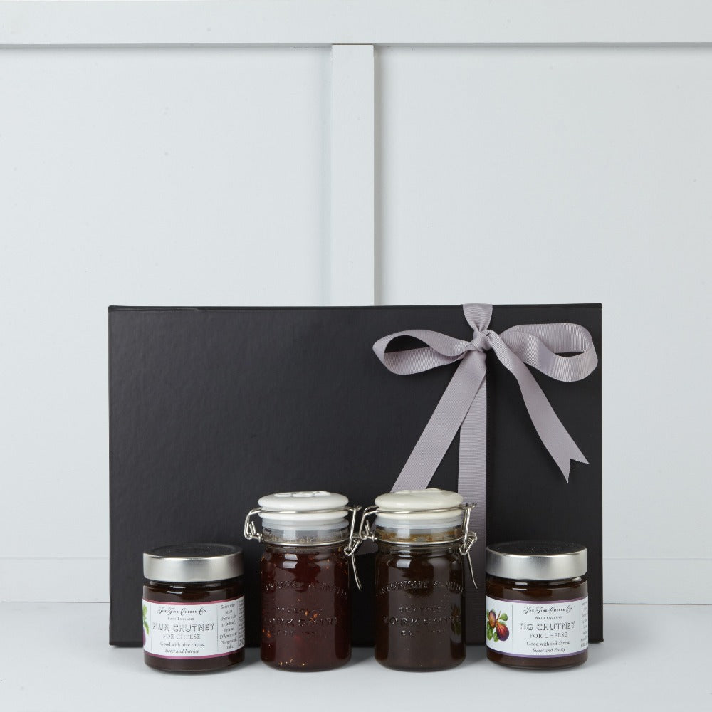 This gift box includes Fig Chutney by The Fine Cheese Company, Plum Chutney by The Fine Cheese Company, Caramalised Onion Chutney by Cartwright & Butler,  Real Ale Chutney by Cartwright & Butler