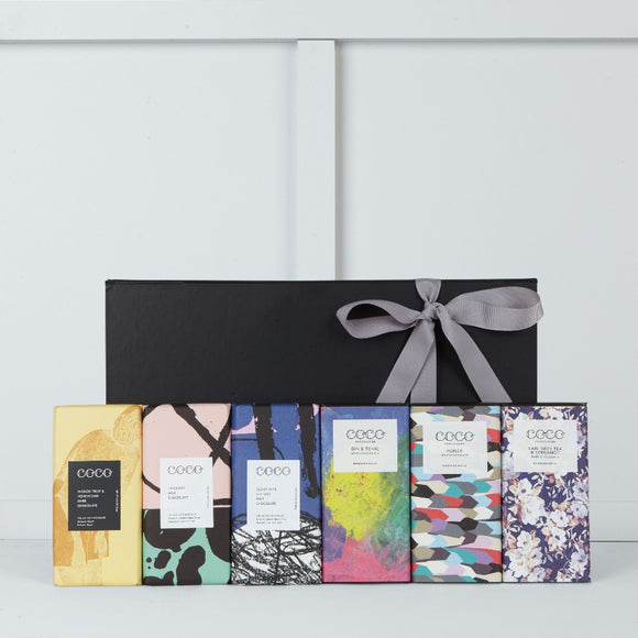 This gift box includes Honey Milk Chocolate Bar, Earl Grey Dark Chocolate Bar, Gin & Tonic Dark Chocolate Bar,  Passion Fruit & Honeycombe Dark Chocolate Bar, Lavender Milk Chocolate Bar, Isle of Skye Sea Salt Milk Chocolate Bar all made by Coco Chocolatier