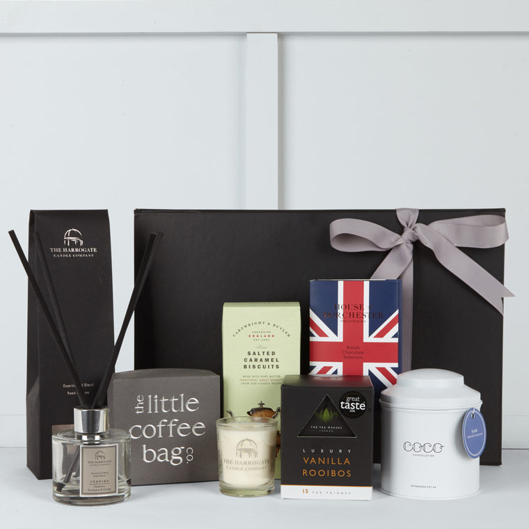 This gift box includes Hot Chocolate by Coco Chocolatier, Vanilla Rooibos Tea Triunes by The Tea Makers, Organic Coffee Blend by The Little Coffee Bag Company, Union Jack British Chocolates by House of Dorchester, Salted Caramel Biscuits by Cartwright & Butler, Scented 10cl Candle by The Harrogate Candle Company & Diffuser by The Harrogate Candle Company