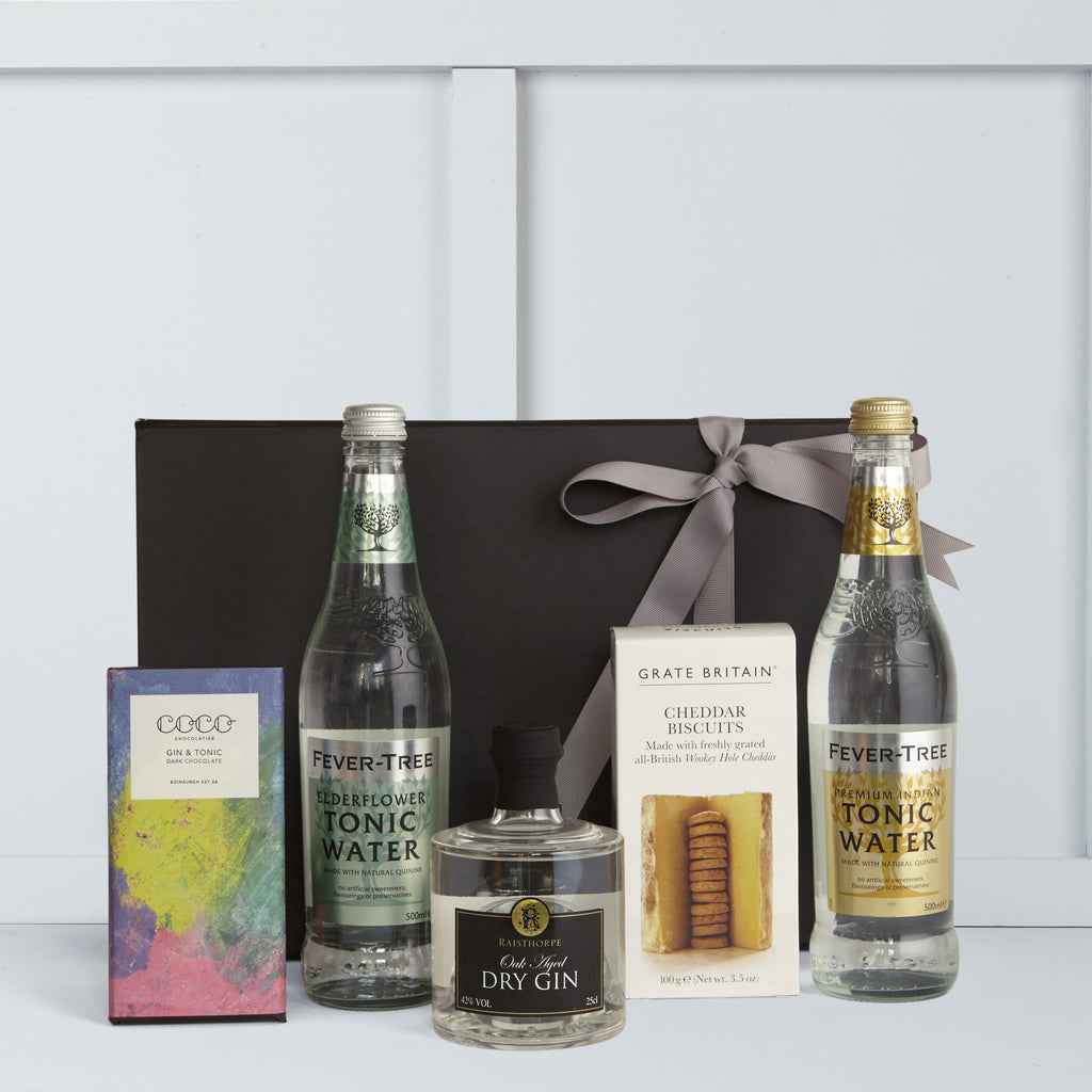 This gift hamper includes Oak Aged Gin by Raisthorpe Manor Fine Foods, Elderflower Tonic Water & Indian Tonic Water by Fever Tree, Gin & Tonic Dark Chocolate Bar by Coco Chocolatier, Cheddar Cheese Biscuits by The Fine Cheese Company