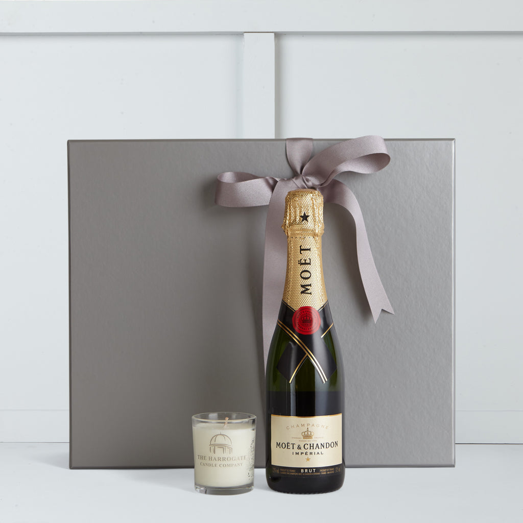This gift box includes Moet et Chandon Champagne 37.5cl Bottle and 10cl Candle by The Harrogate Candle Company
