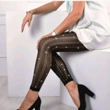 Striped sheer trousers with glittering stars