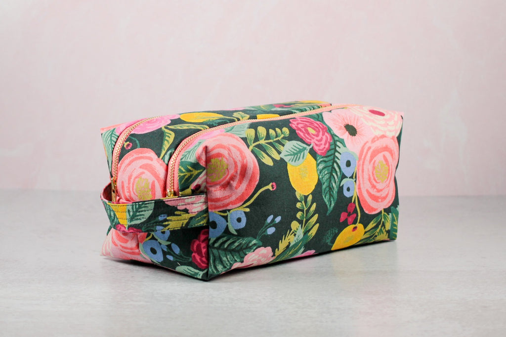 side view of floral double zip toiletry case