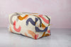 large abstract dopp kit with navy zipper