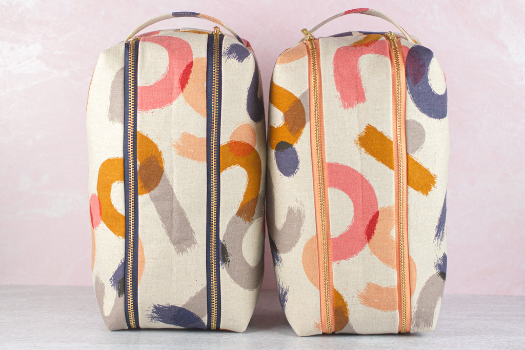 two dopp kits side by side by modern tally