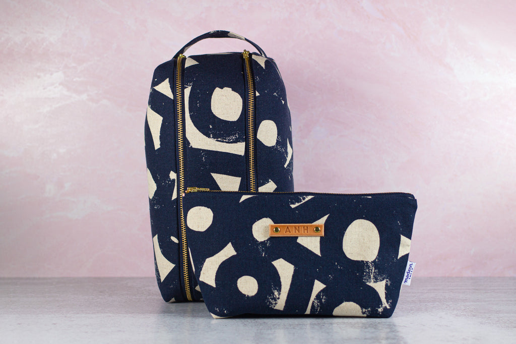gift set of navy makeup bag and dopp kit