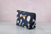 side angle of monogrammed makeup bag by modern tally