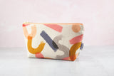 Peach zipper pouch in abstract brushstrokes