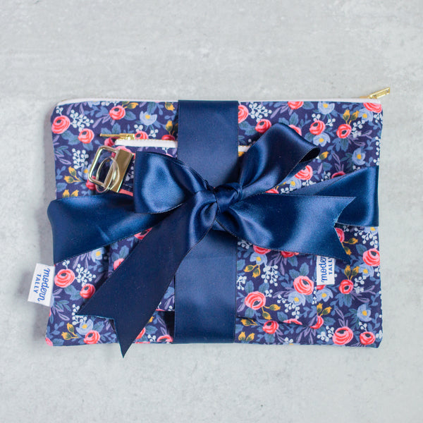 a matching set of pouches tied with a satin ribbon