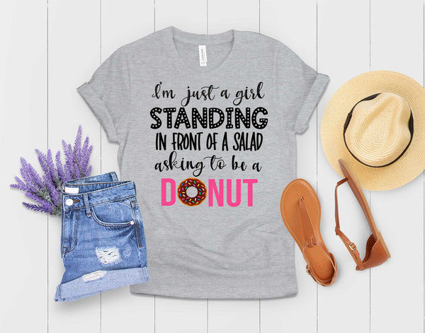 Just a girl standing in front of a salad asking it to be a donut