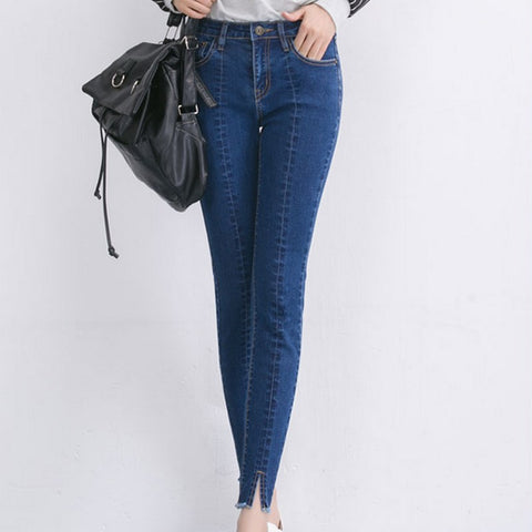 Blue denim trousers with high ankle cut detail