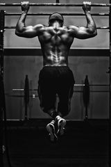 Weight lifter doing a pull-up - Affordable Pre Workout Energy Supplements