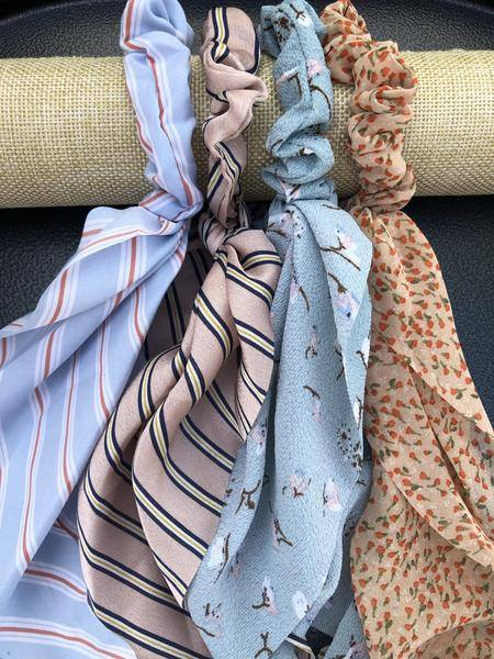 Light and soft chiffon scarf scrunchies are the it accessory! Add a little something extra to your typical hair style! These are so cure for Spring!