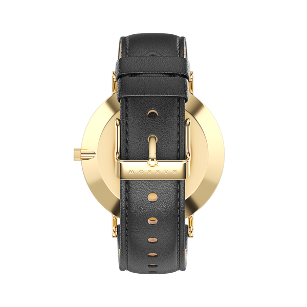 Gold watch with black watch strap reverse