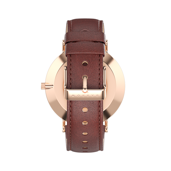 Rose gold watch with brown watch strap