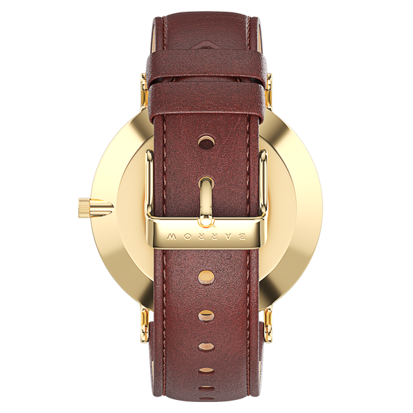 Gold watch with brown watch strap reverse view