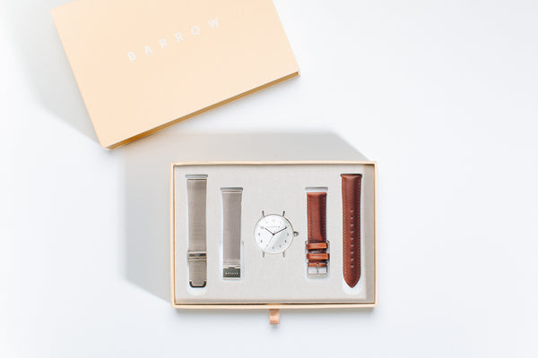 silver watch with two watch straps in box
