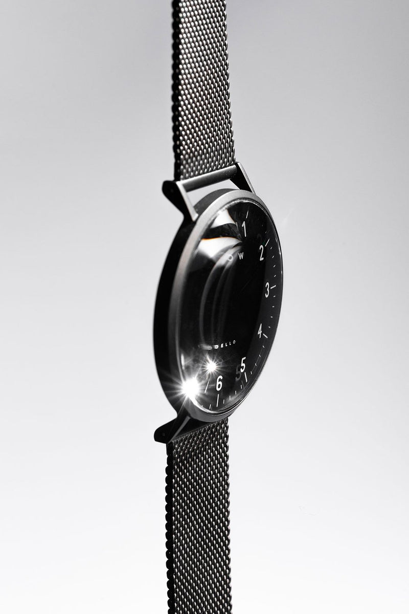 Black watch with black mesh watch strap side view