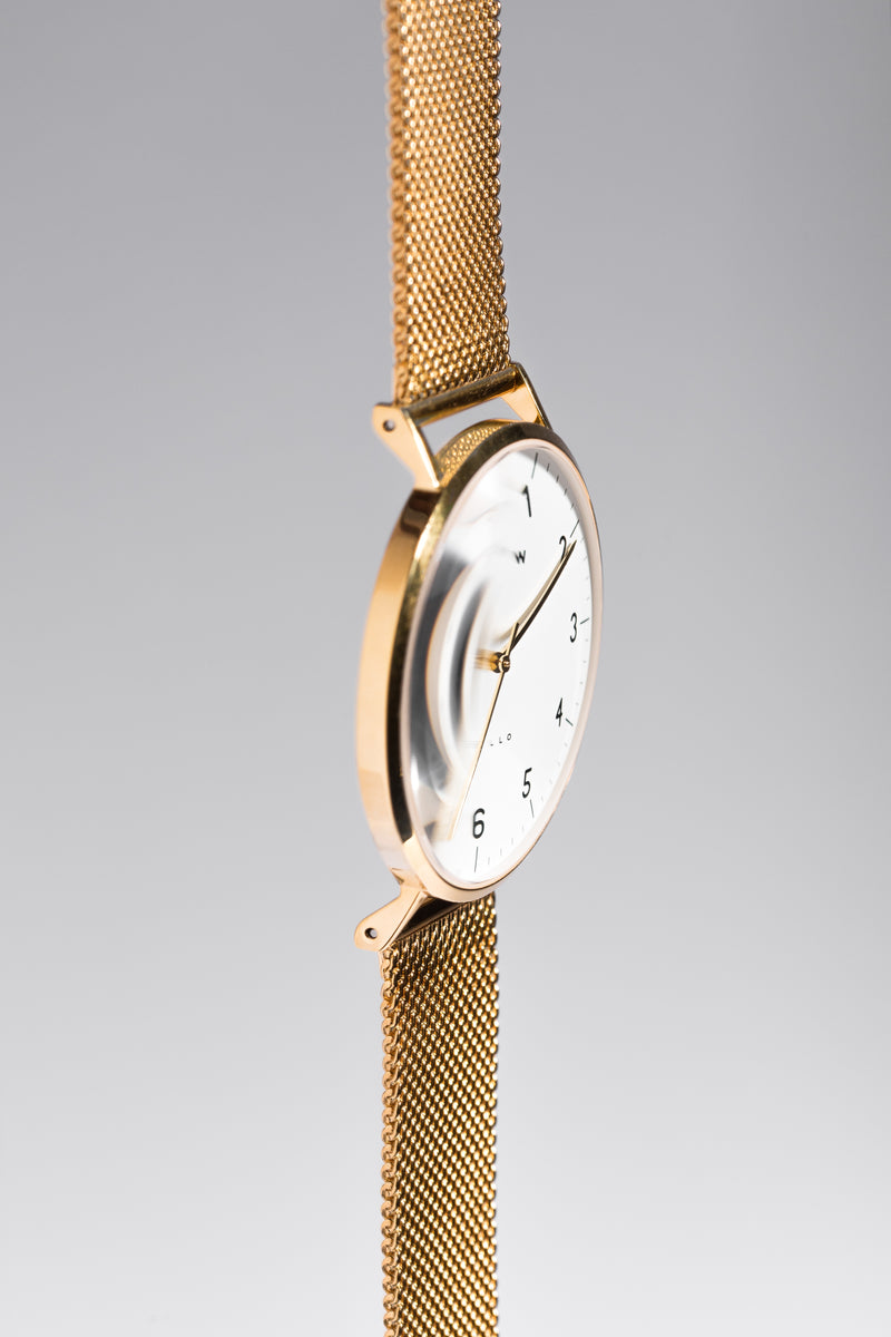 Gold watch with gold mesh watch strap