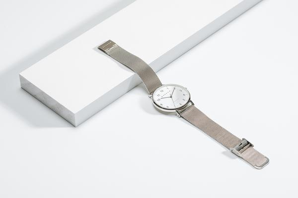Silver watch with silver mesh watch strap