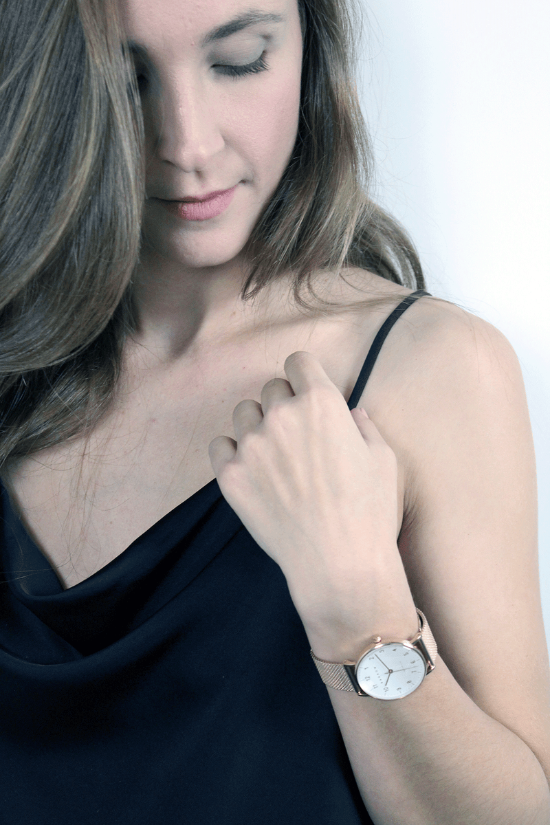 Woman wearing petite rose gold watch