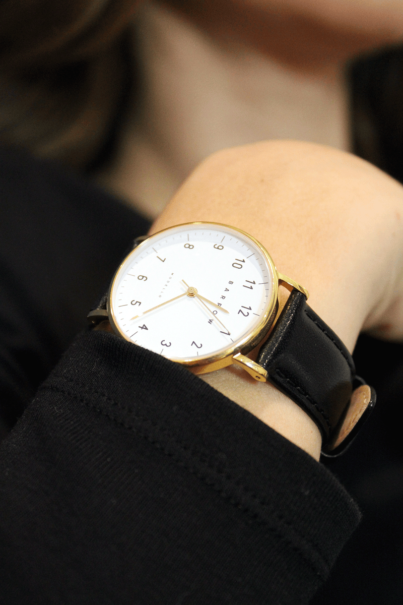 Female wearing Barrow Petite gold and black watch