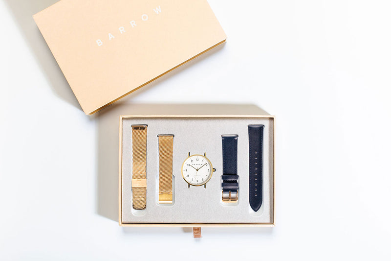 Gold watch with two watch straps in box