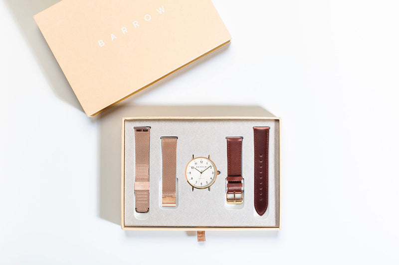 Small watch in box includes two watch straps